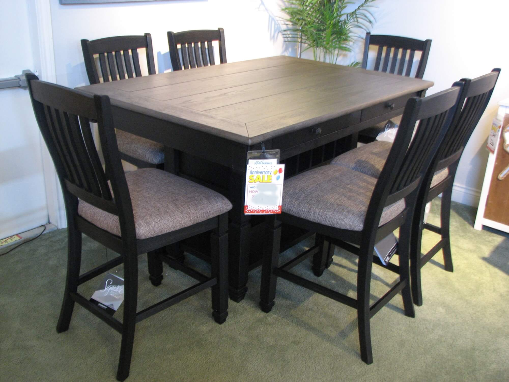 Ashley Rustic Black Pub Dining Table with Six Upholstered Chairs